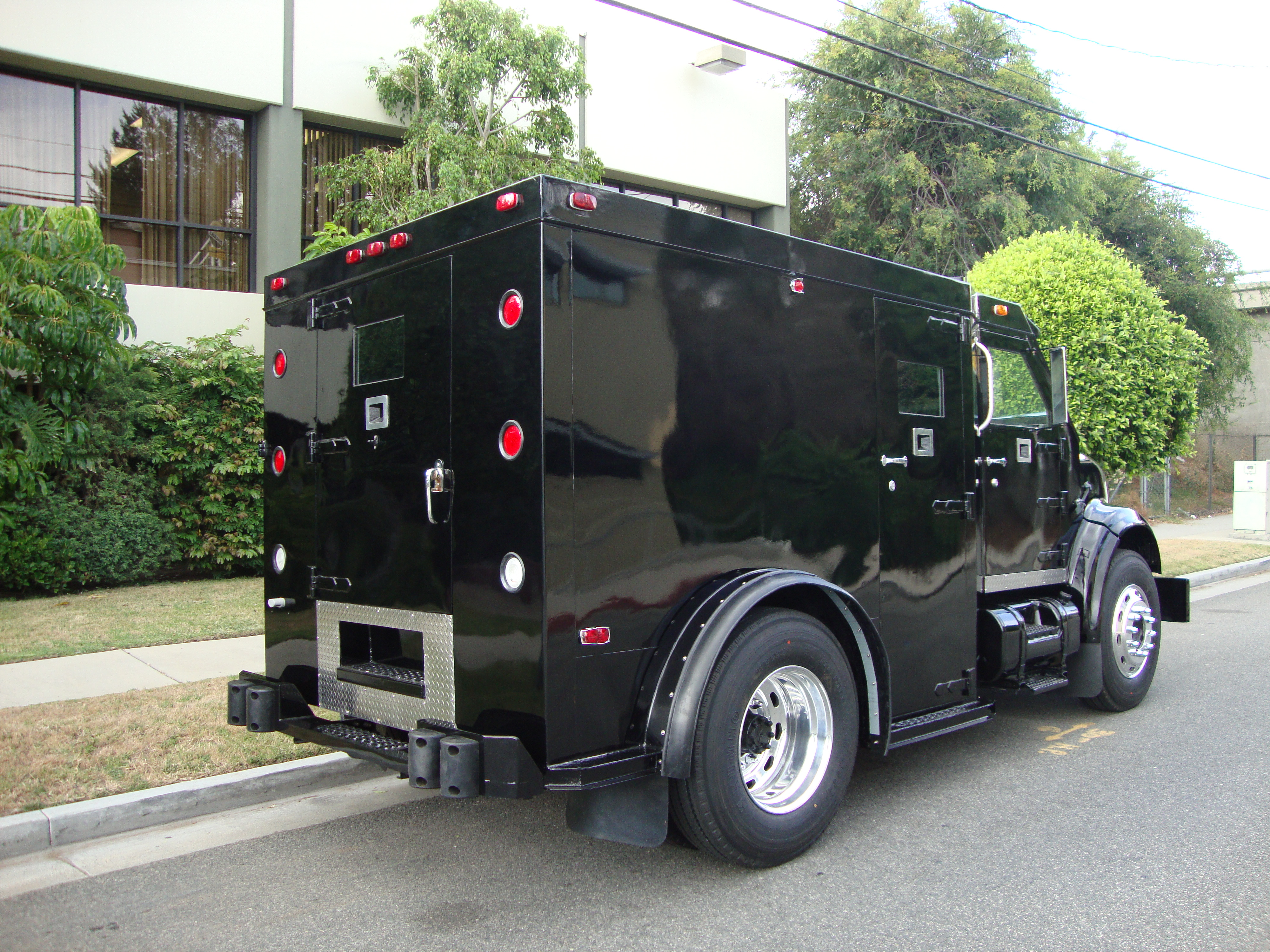Armored Vehicles For Sale >> Refurbished International 4700 Custom Ordered Armored Truck Back Side | CBS Armored Trucks
